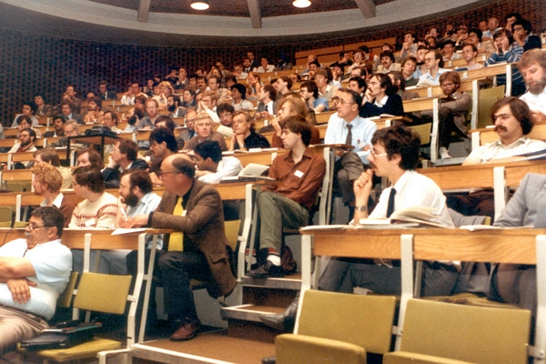 DCS Conference, University of Sussex, 1984 (Roger Needham, front row of seats with yellow tie)